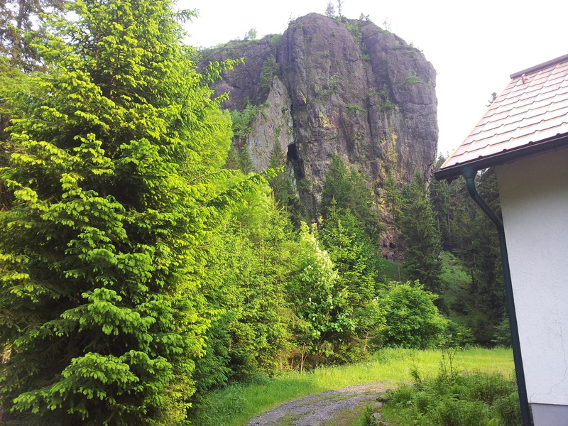 """The pride of Thüringen, the """"Falkenstein"""" with its 70m high north-west face. The cabin on the right is the local mountain rescue station."""