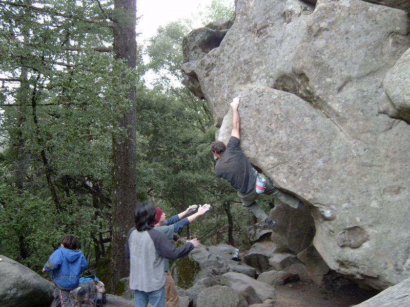 Charlie M. sending V4 boulder to the left of Chalk Stone.