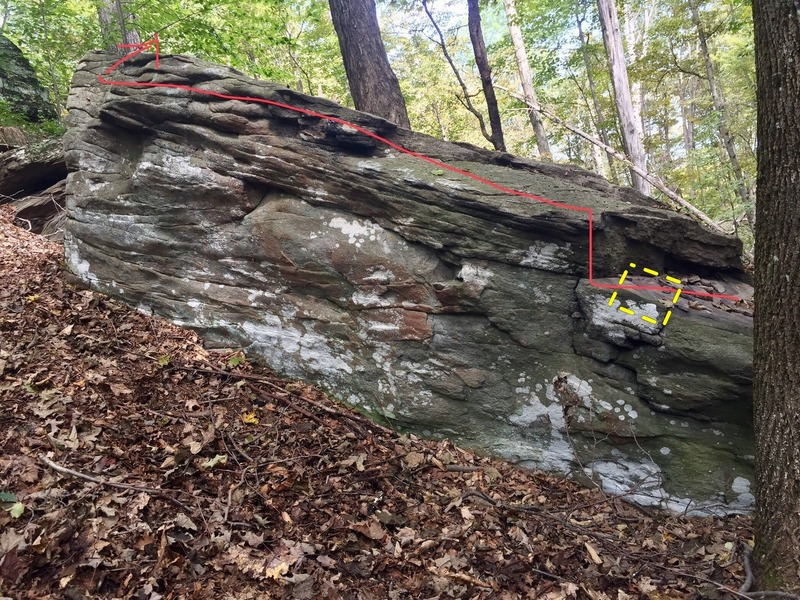Start with your hands on the lower ledge all the way on the right (yellow box), hook a heel and then keep on hooking! (there;s a few good pockets for your feet along the way too.