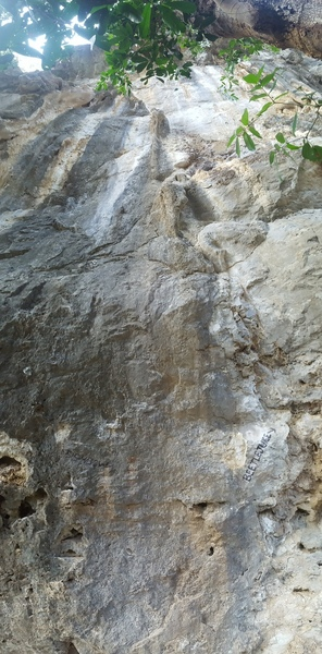 Tackle the darker rock on the left side of the photo.
