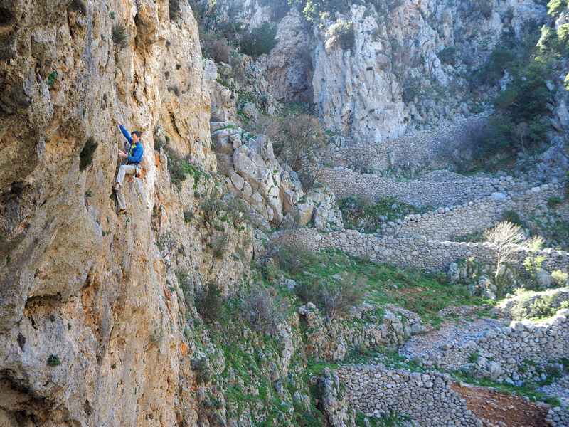 Paliochora (6b+) at Stavros, with the ancient road in the background.