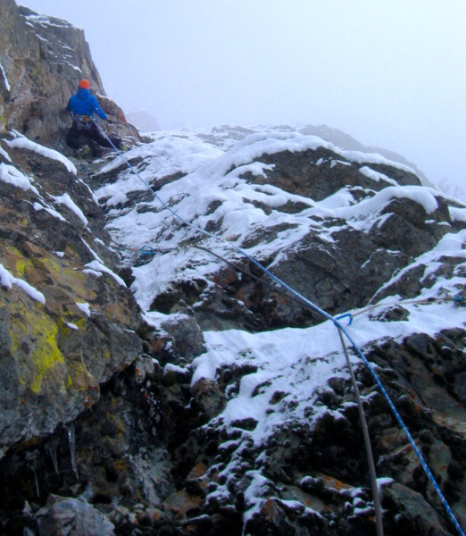 Mark Allen on the M6 crux of pitch 3 in snowy conditions during the opening of pitches 5-6 &7 in 2018. Photo: Seth Keena-Levin
