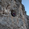 Derek on route and reloading his rope gun in the hueco.