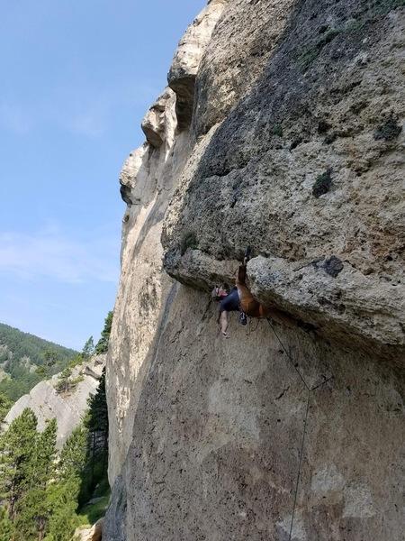 Bighorn Climbers' Coalition Prez, Alex Green, heel hooking through the Zero Chill roof.
