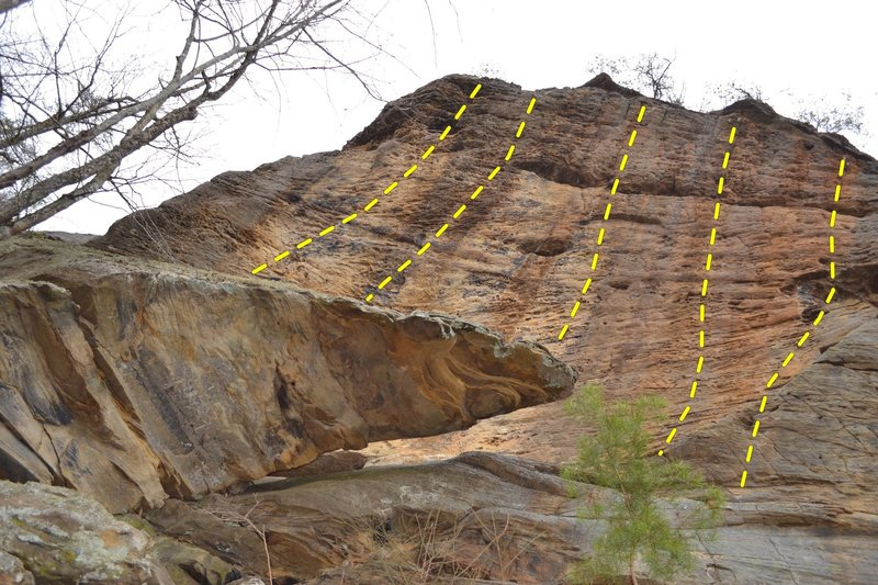 looking up at the first 5 routes at The Port from below the belay ledge. To access these 5 you go up and a round to the left <br> (the 2nd and 3rd route in this picture are Open come get the FA)