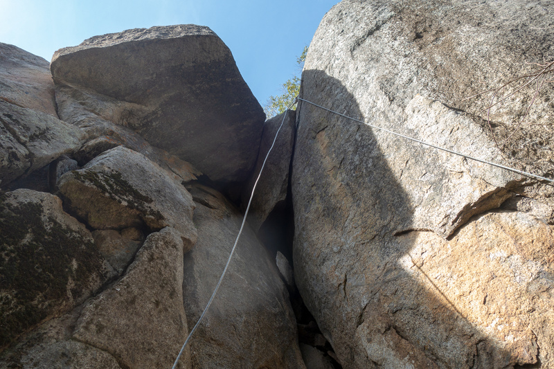 Batman (5.11) is the crack/flake  with the rope slightly to the right scorpion roof crack (5.11)