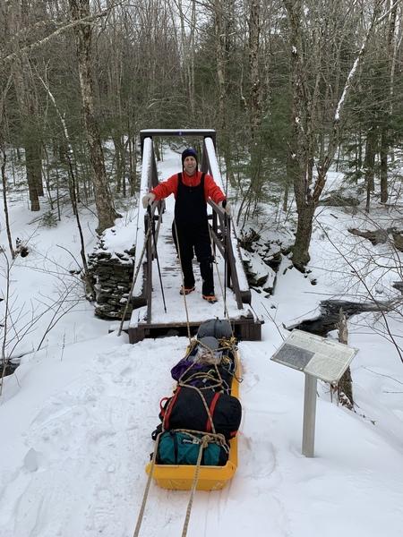 Sledding climbing gear into the Black Chasm from Platt Cove Road. Winter 2019. A major back saver!