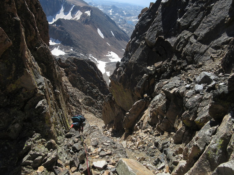 Charlotte descending the loose chute beneath the cl. 4 downclimb, before more enjoyable cl. 3-4 ridge scrambling.