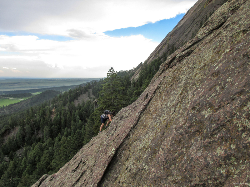 A climber on Freeway Ridge about 100 feet below the jump. The rock where the climber is is less steep and has a bit more texture.