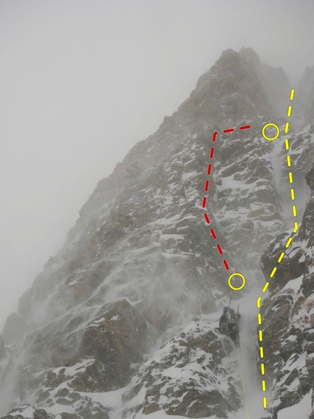 A climber on pitch 1 of Tastee Freeze, Feb./Mar. 2019. The route follows the spindrift. The dihedral variation to pitch 2 (red) looks inviting but becomes very loose halfway up. Not recommended.