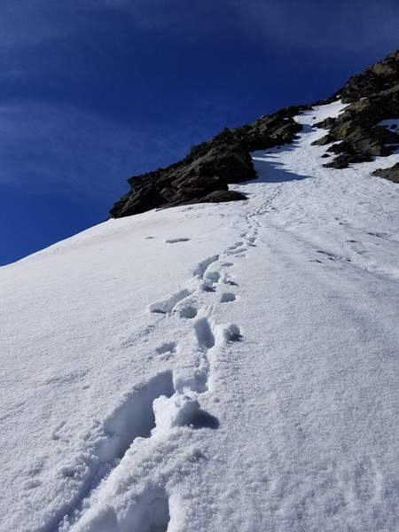 Narrow snow gully on the route.
