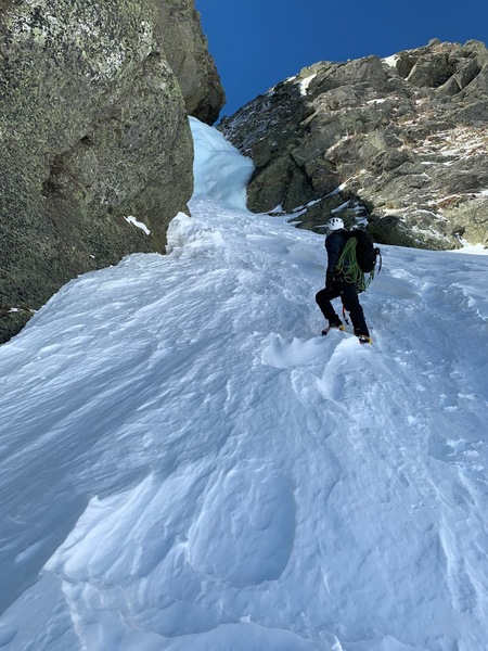 Parker looking up the first pitch of ice on Pinnacle Gully