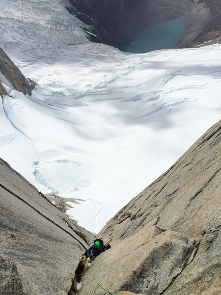 Josie McKee climbing up the corner towards the col from the eastern approach with Laguna Sucia below