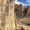 East Coast snowboard coaches Ian Kirk (climbing) and Bud Keene enjoy a down day away from stormy Mammoth.