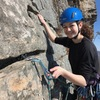 """Caroline placing a bomber cam during her first trad lead on """"Ribs""""."""