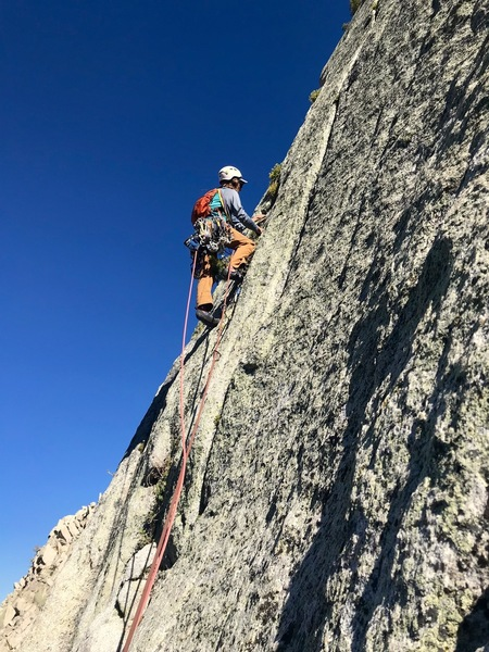Starting up the 7th pitch. Tricky slab move gains the thin crack, soon widens to hands. Photo: Giselle Field