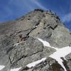 South Face of The Tooth 3/16/2019. Face gets enough sun that even during a winter ascent its got dry rock. <br> <br> Rock moves are dry, but patches of snow and lots of snow on summit makes having an ice axe or tool useful towards end of route and summit.
