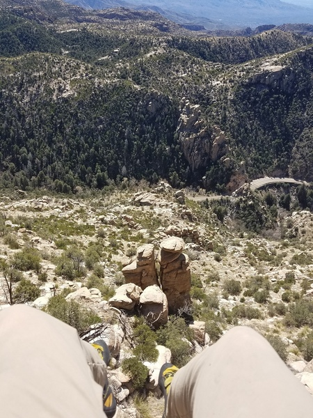 Sitting on the little ledge at the top overlooking Bear Canyon.  The crag across the way near the road  is Green Slabs