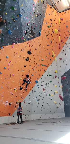 Starting up a route on the steep lead wall