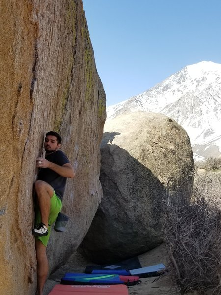 Finding the good undercling above the left hand start hold.