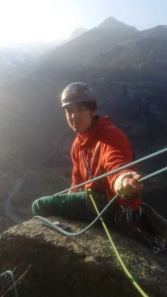 Dan belaying from the top of p4