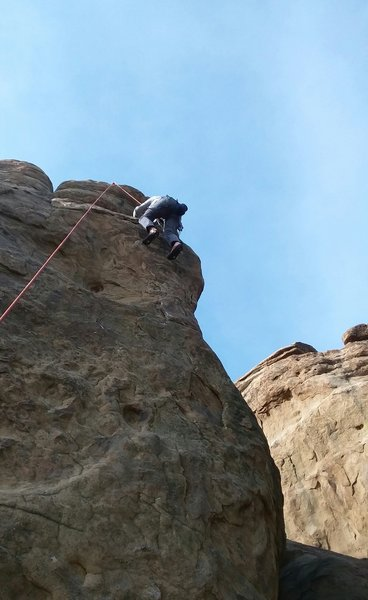 Adam topping out on the Unknown Route.