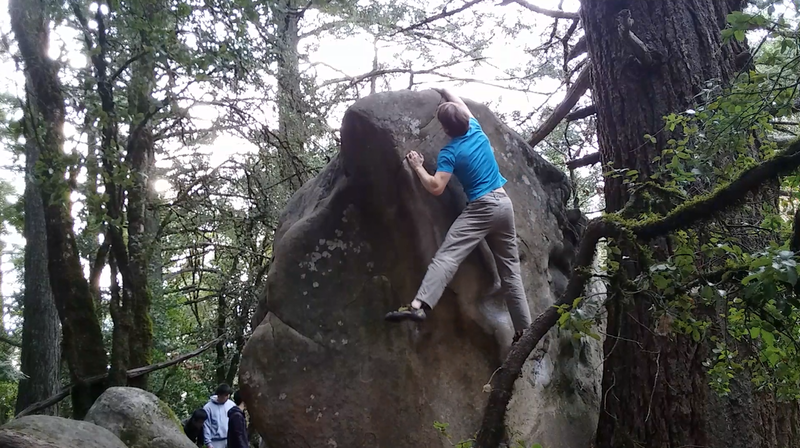 Grabbing the top after a nice dyno.  Use the left hand crimp and the undercling visible by the right knee to launch.