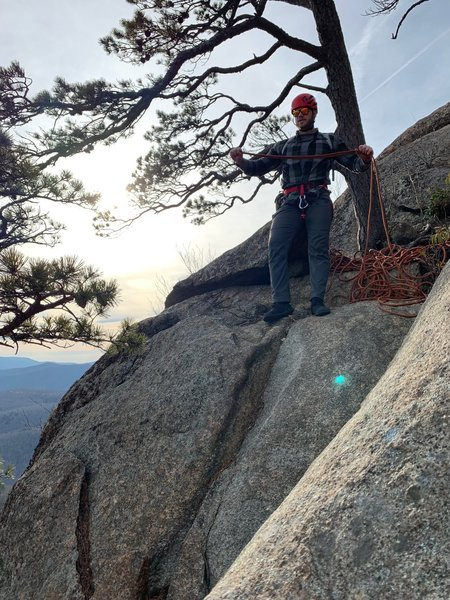 Aaron starting to coil the rope after a fun toproping session on Begginer Slab. Picture taken from the bolt anchor.