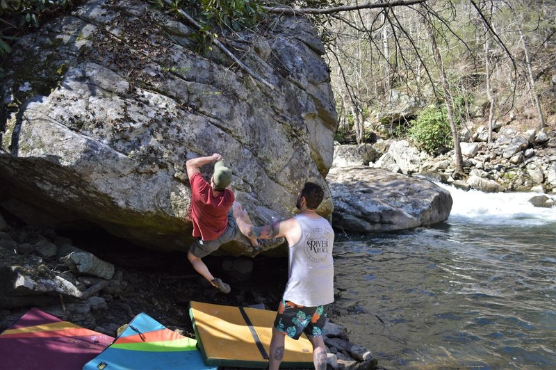 """Marsh slinging hands on the 2nd ascent of """"Silent Majority"""" while Nathan wears a wonderfully on-the-nose River Rock tank top."""