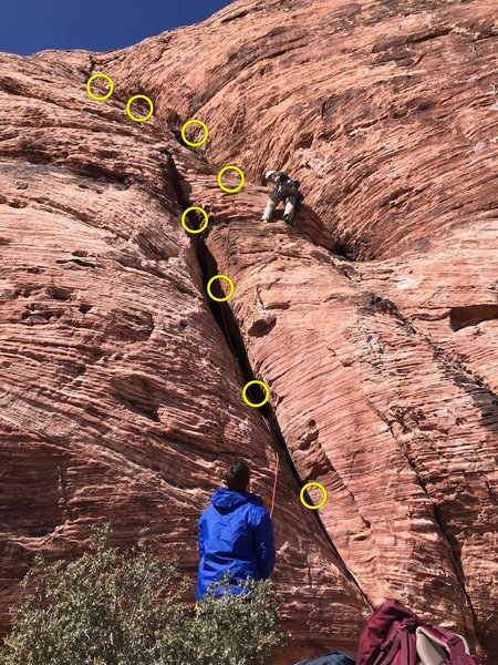 Making the traverse. Might be able to reduce rope drag by putting a piece high in the left crack before traversing over to the right crack rather than traversing low like I am doing in the picture.
