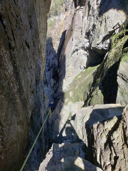 Rappel from the rear of the Mummy Buttress through the side gully. Takes a single rap of a short rope (50, 60, 70m)