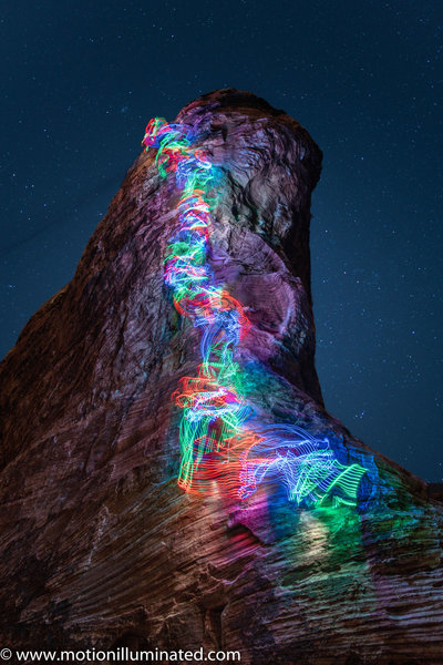 Long exposure shot with LEDs tied to climber