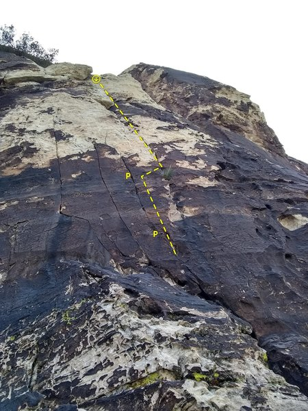 Climb starts up the thin seam past two pitons then moves right to the white crack starting from the small bush and follows it to the top to a 2 bolt anchor shared with the sport climb to the right.