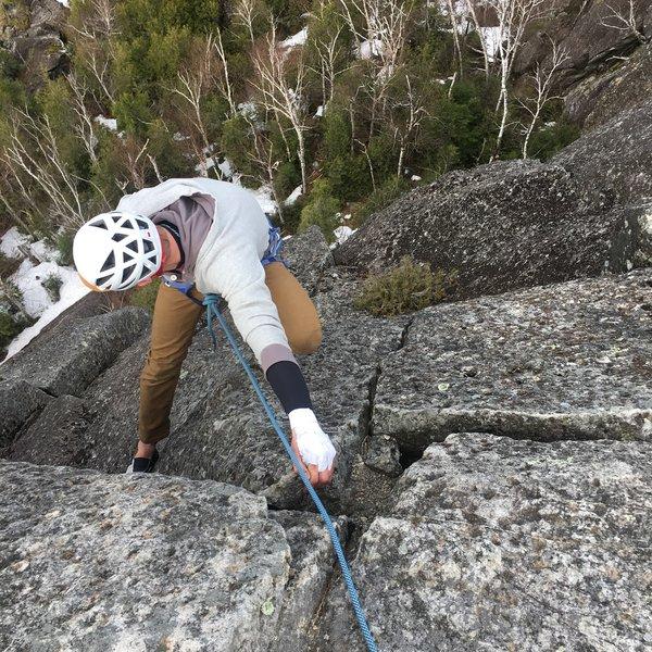 Hero jug on the top of Equinox.<br> <br> Photo: Logan Dop<br> Climber: Kyle Ellefson