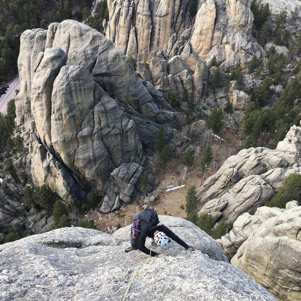 Joe Reichling finishing the runout slab on the last pitch of The Buck Stops Here.<br> <br> Photo: Logan Dop