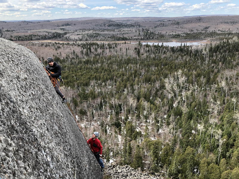 Noah K belaying Connor K right after he worked through the crux.