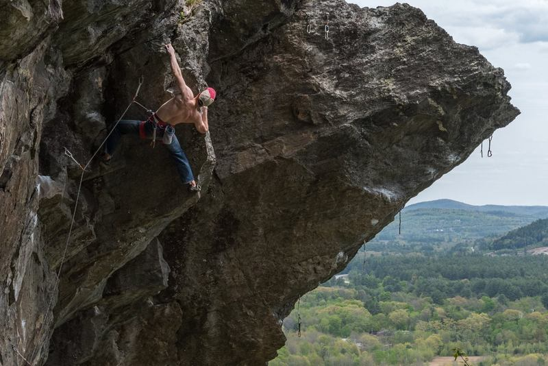 """Ian on """"the Crusher"""" (5.11d), Rumney, NH. (That's Predator to the right, of course.)"""