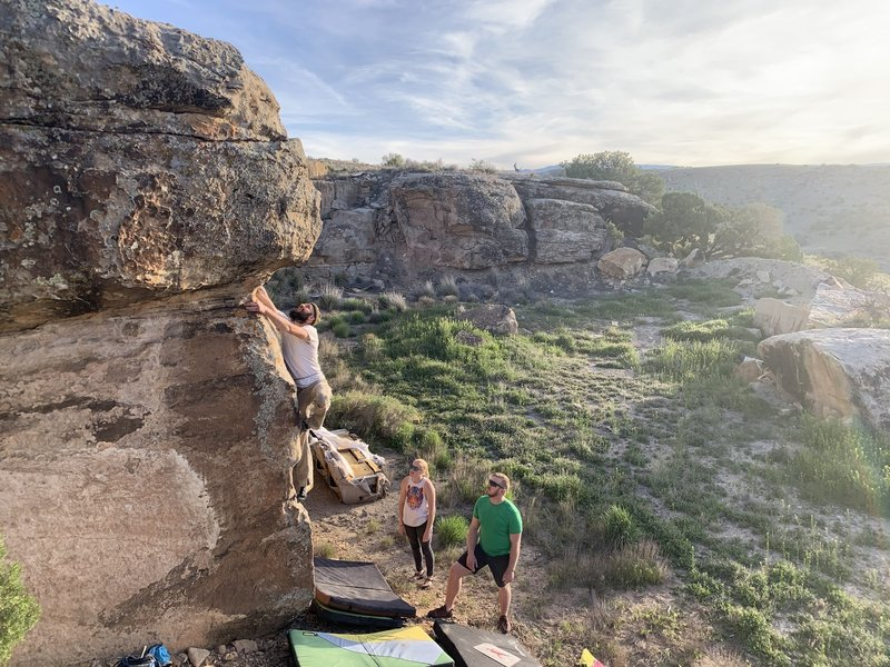 Jake moving into the crux...with great spotters!
