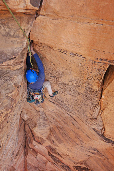 Zach on the featured rock through the steep exit to P2.