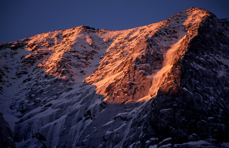 Day 4 - Sunrise on the South Peak and Armadillo Buttress. The route is clearly visible to the left of the summer route.