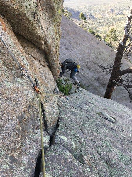Brandon Gottung on the downclimb pitch (P6).