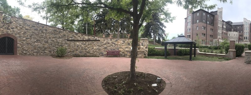 This photo shows the entrance (on the right of the photo) and the rest of the wall and patio.