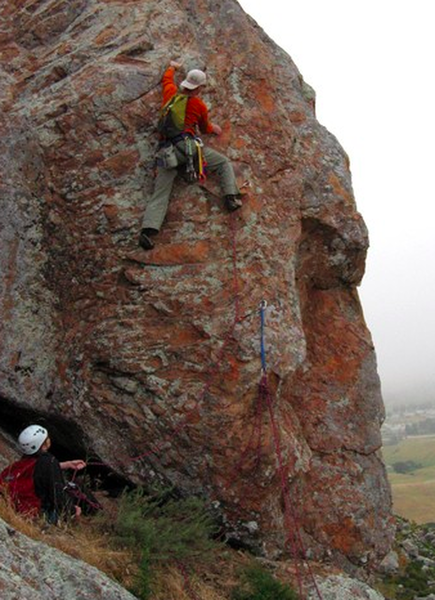 Slater climbing pitch 4 (Hobbit Arete) of The Backdoor. You can use the lower bolt as an anchor for a belay.