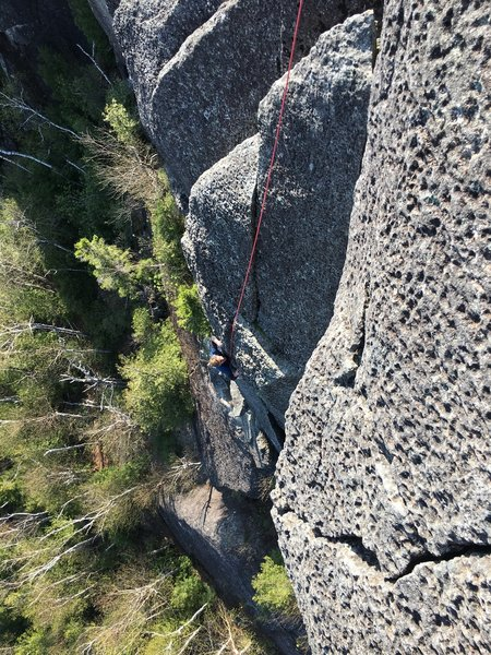 Blane just past the crux face moves on Arrowhead Direct.<br> <br> Photo: Chad Heying