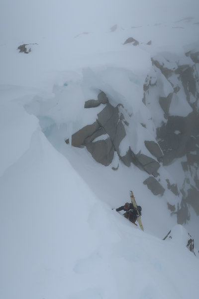 Topping out the Harrington Couloir in spring pow conditions (and poor visibility)