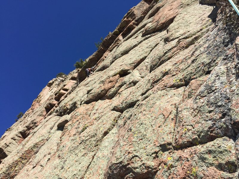 Daniel A. Working the undercling traverse on pitch 4 standard route.