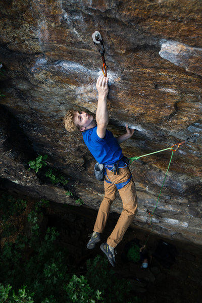 Carter Ley cuts feet under the fifth bolt on The Sins of the Son (5.10b). Photo by Henry Ley.