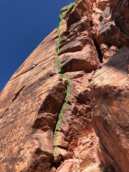 The route climbs the overhung off width onto a small ledge then continue's up as the crack get smaller. Then face climbing with a couple tricky moves gets you to a rappel station
