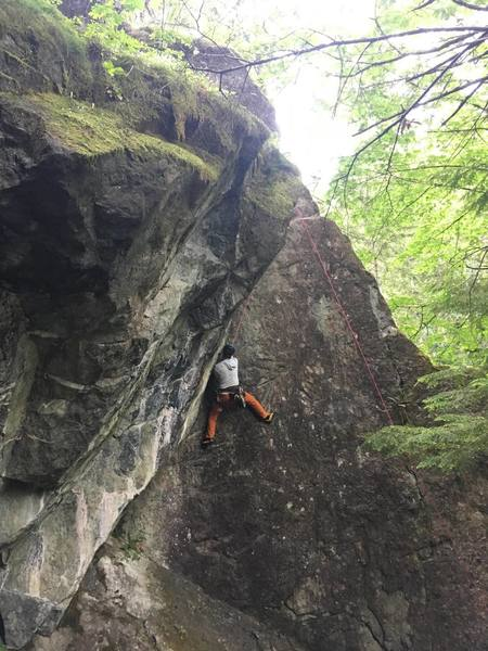 Zach using a welcome foothold on the very steep hand crack