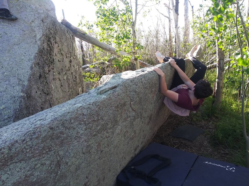 Kayleen working in multiple heel hooks as she gets 1/3 way through the climb.
